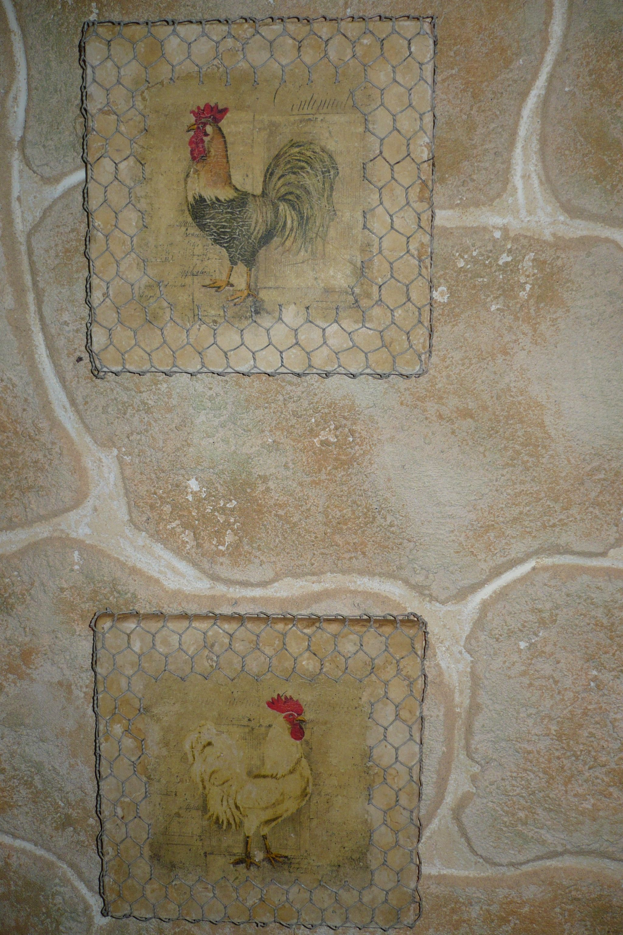 A Picture Of Roosters On Ceramic Tile With A Frame Made