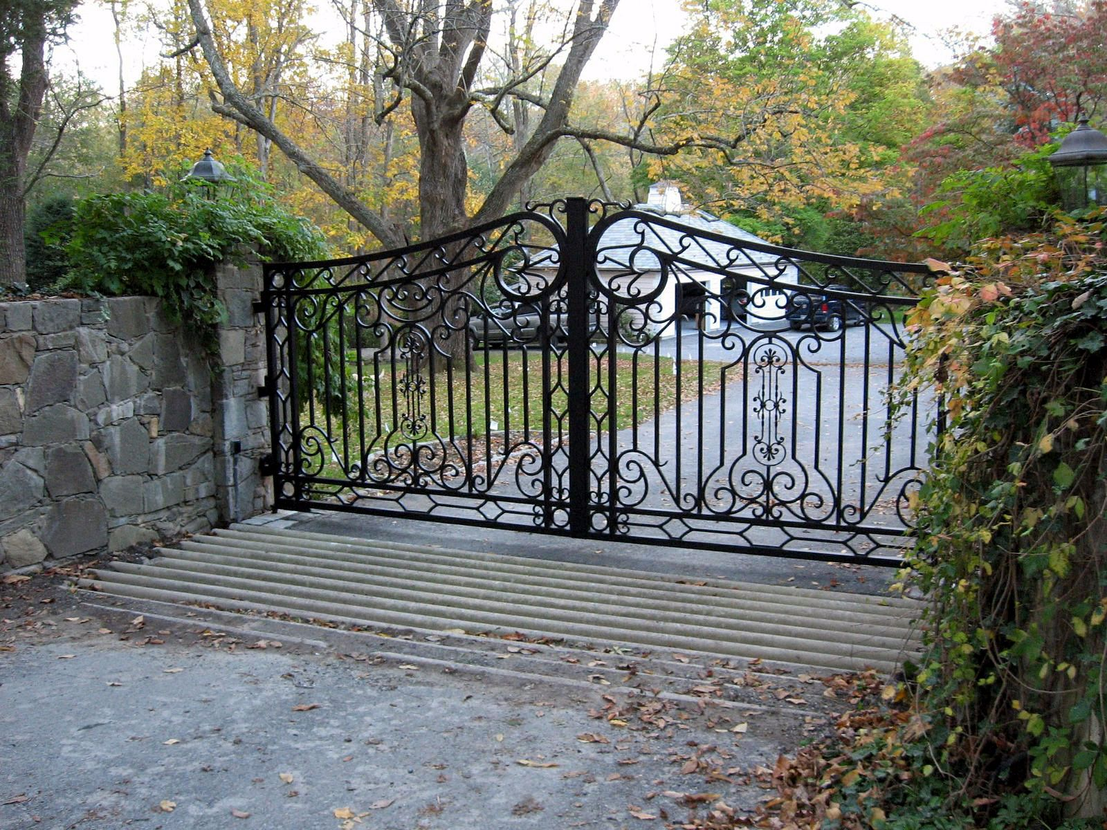 This Wrought Iron Driveway Gate Features Traditional Scroll