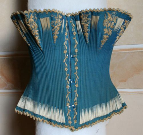 Corset ca. 1866 via Abiti Antichi  With the invention of cheap, vivid synthetic dyes, underwear once again became colorful.
