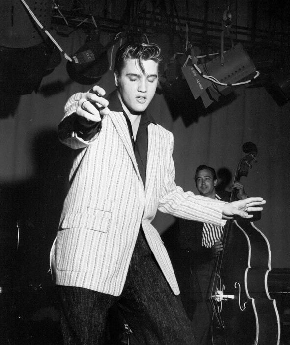 Rock and roll musician Elvis Presley rehearsing for his performance the Milton Berle Show on June 4, 1956 in Burbank, California