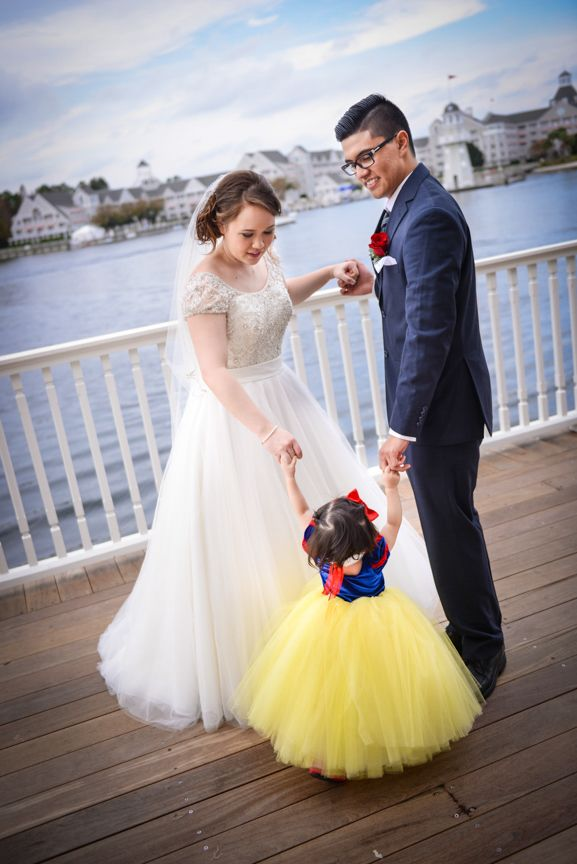 A little Snow White shared a dance with the bride and groom at this Walt Disney World wedding