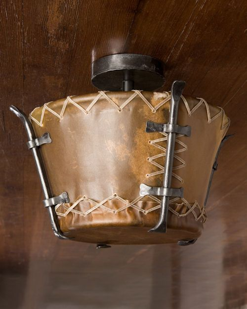 When it came to communicating over long distances, rawhide preceded the telegraph. Rawhide was the medium with which the drummers could speak fluently. Many tribes spoke  in their own code or language. Here we have a simple, classic ceiling light which, though not in actual drum form, features the beautiful material that the Native Americans found useful in so many ways: rawhide!  The Our standard size starts at 12 inch diameter and can be scaled up to as large as 30 inches upon request.