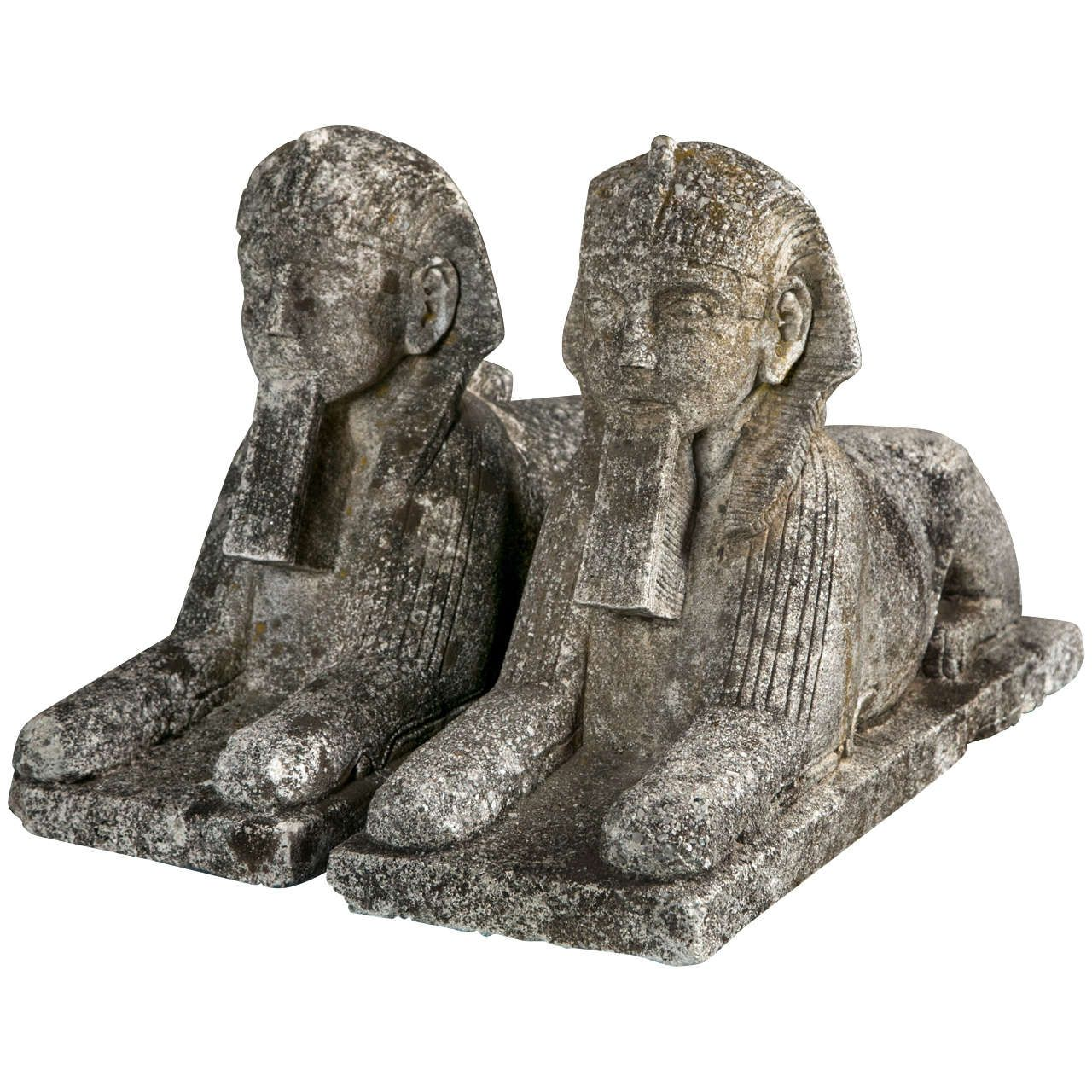 A Pair Of Cast Stone Sphinx Garden Ornaments. HEIGHT: 17.5 In. (44