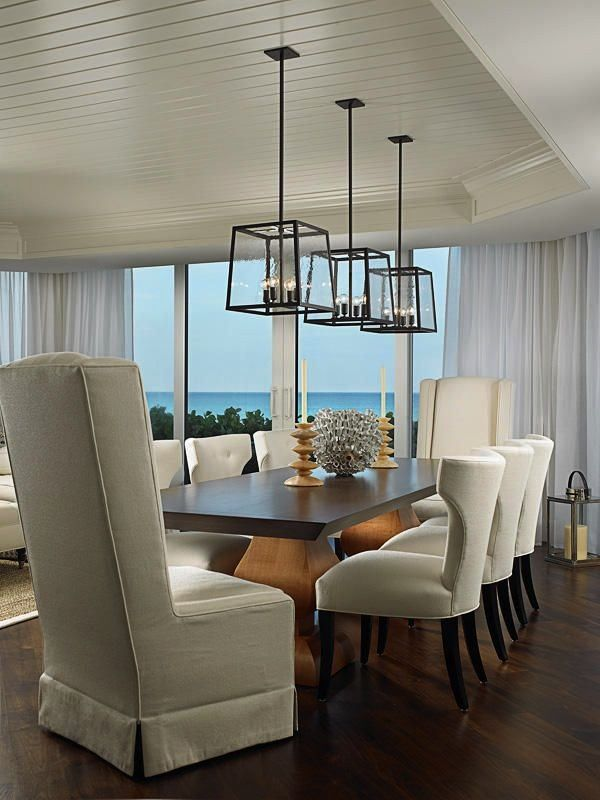 Find coastal dining room design ideas for your beach style home with white coastal furniture and nautical decor featuring shell lighting slipcover dining