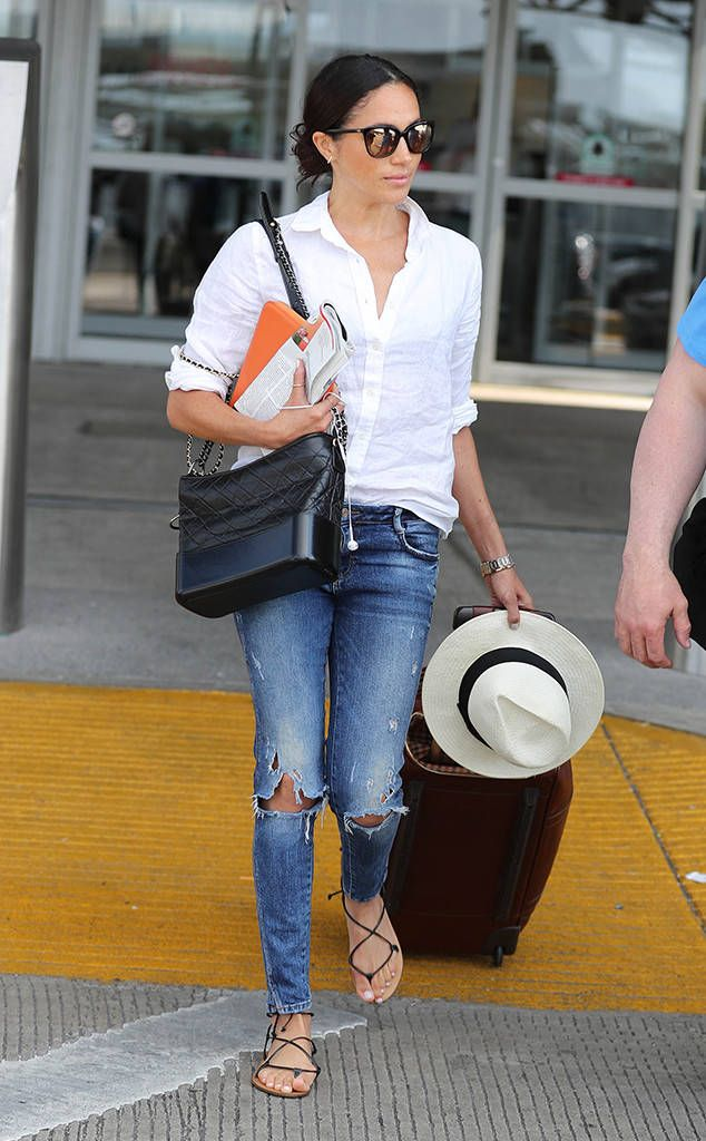70eb3e7e70 Meghan Markle from The Big Picture  Today s Hot Photos Jet setter! The  actress travels in style wearing ripped jeans