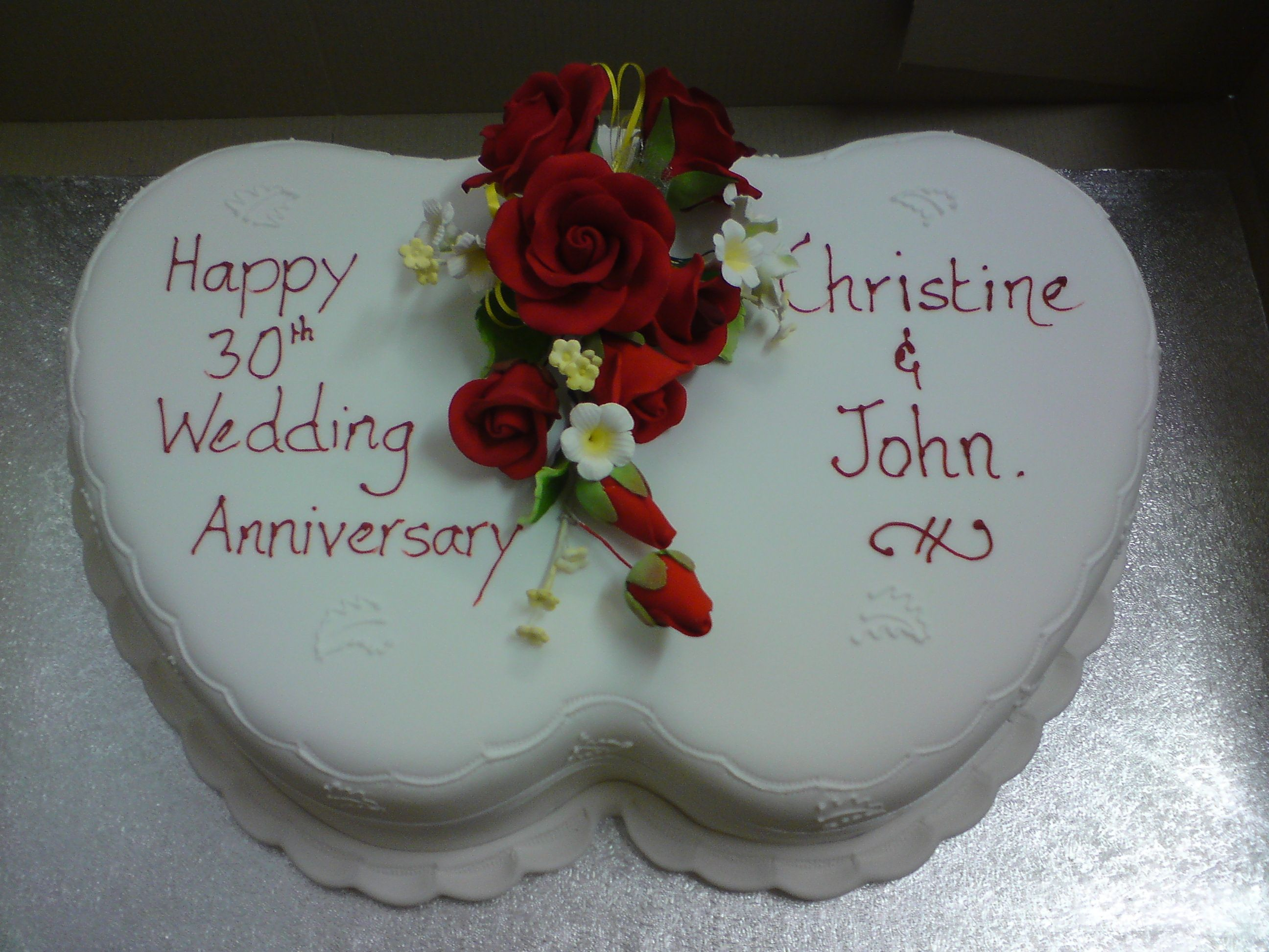 Wedding anniversary cake, two hearts with floral