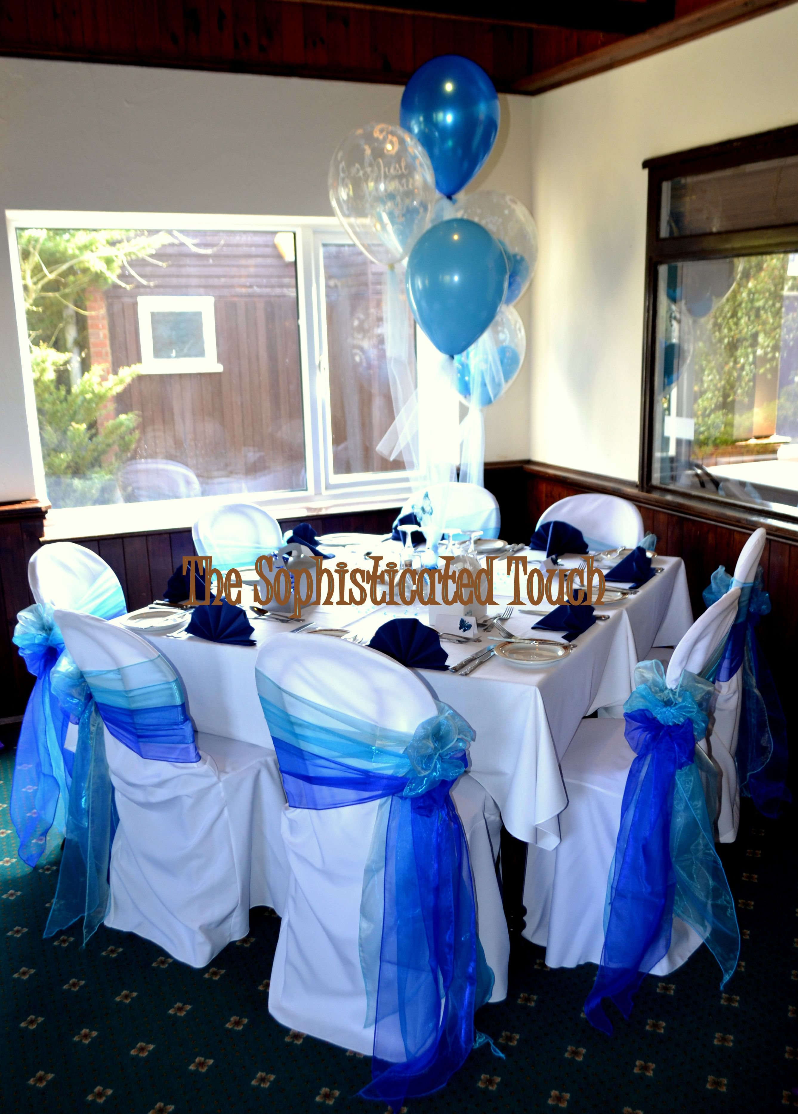 Blue Ombre Organza Bows on White Chair Covers The