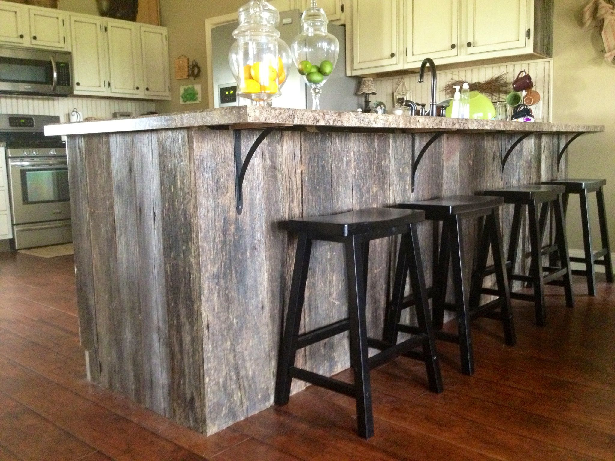 Reclaimed Barn Wood We Wrapped Our Island With Barn Wood To Give Our New Home An Old Feel Rustic Kitchen Wood Kitchen Island Barn Wood