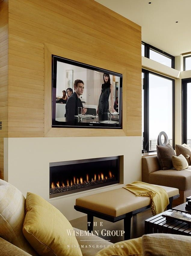 Sparks fireplace with white painted wood above and ...