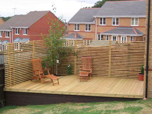 Decking sloping garden google search garden for Garden decking fitters