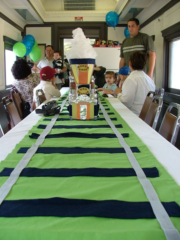 train party table runner as tracks set snack cars