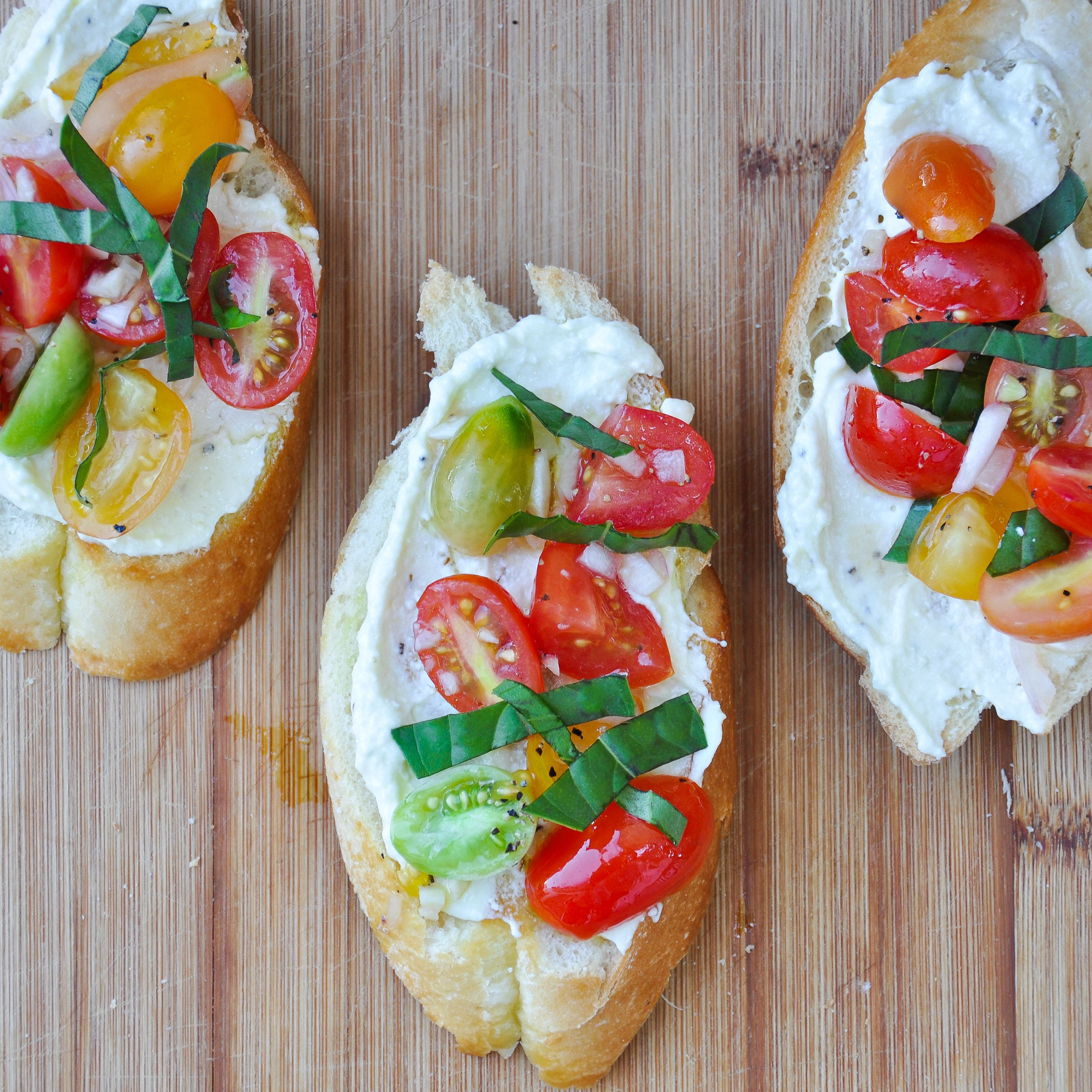 fresh and so flavorful, Crostini with Whipped Feta and Tomatoes makes the perfect spring or summer appetizer or light meal.