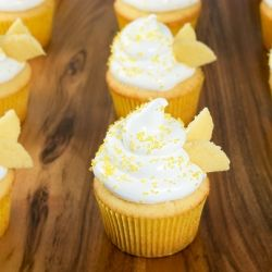 Light and moist honey-kissed filled yellow cupcakes