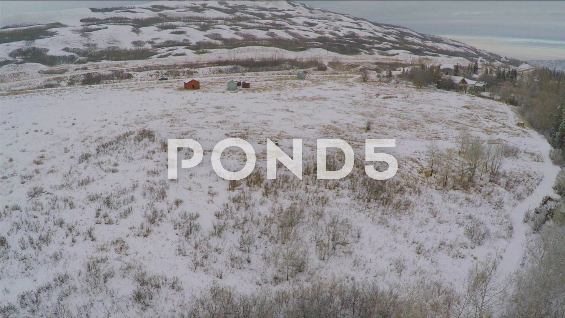 Aerial Shot Abandoned Barn Snow Field Hills Trees Winter Drone Footage - Stock Footage   by RyanJonesFilms
