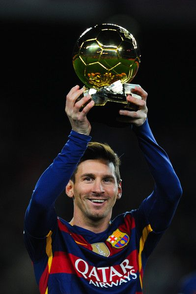 Lionel Messi of FC Barcelona holds up the FIFA Ballon d'Or trophy prior to the La Liga match between FC Barcelona and Athletic Club de Bilbao at Camp Nou on January 17, 2016 in Barcelona