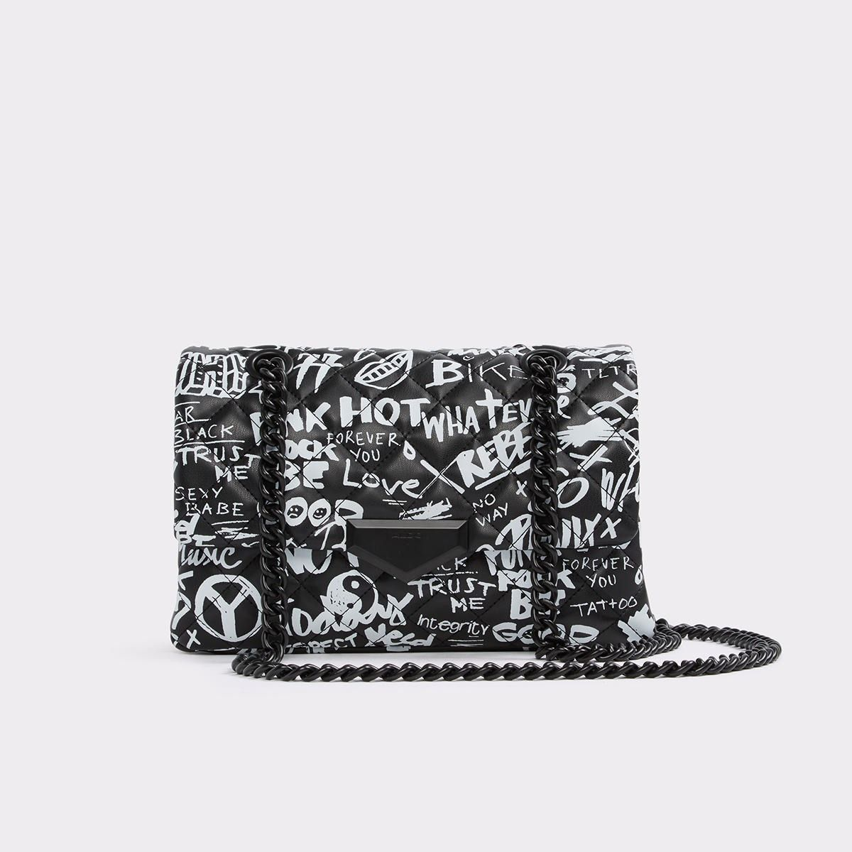 69d4cb0589 Caldenno This illicit little bag has a lot to say yet not punishable by  law. Express yourself with our quilted graffiti crossbodywith magnetic snap  ...