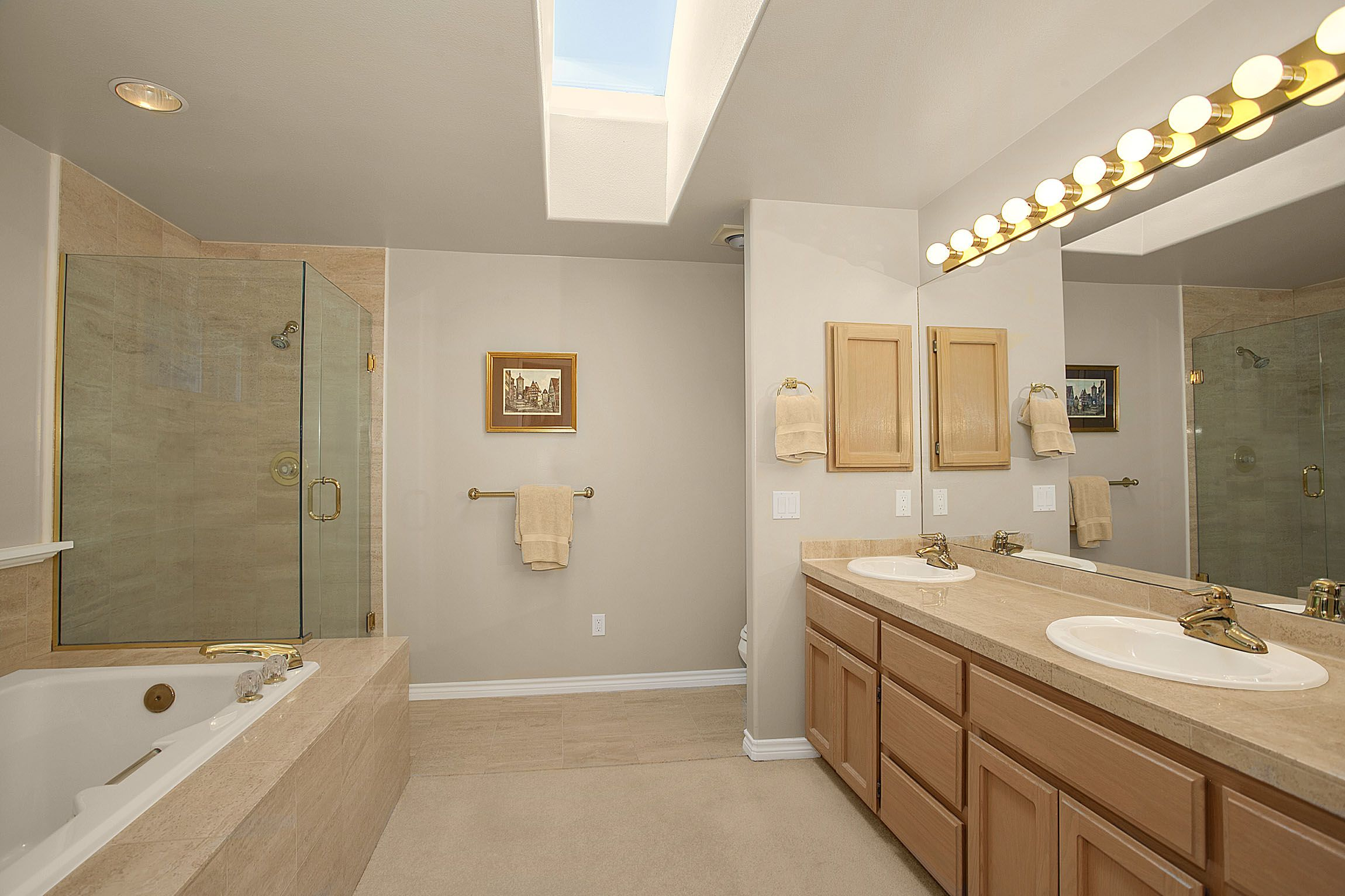 Master bathroom with creme colored travertine marble ...