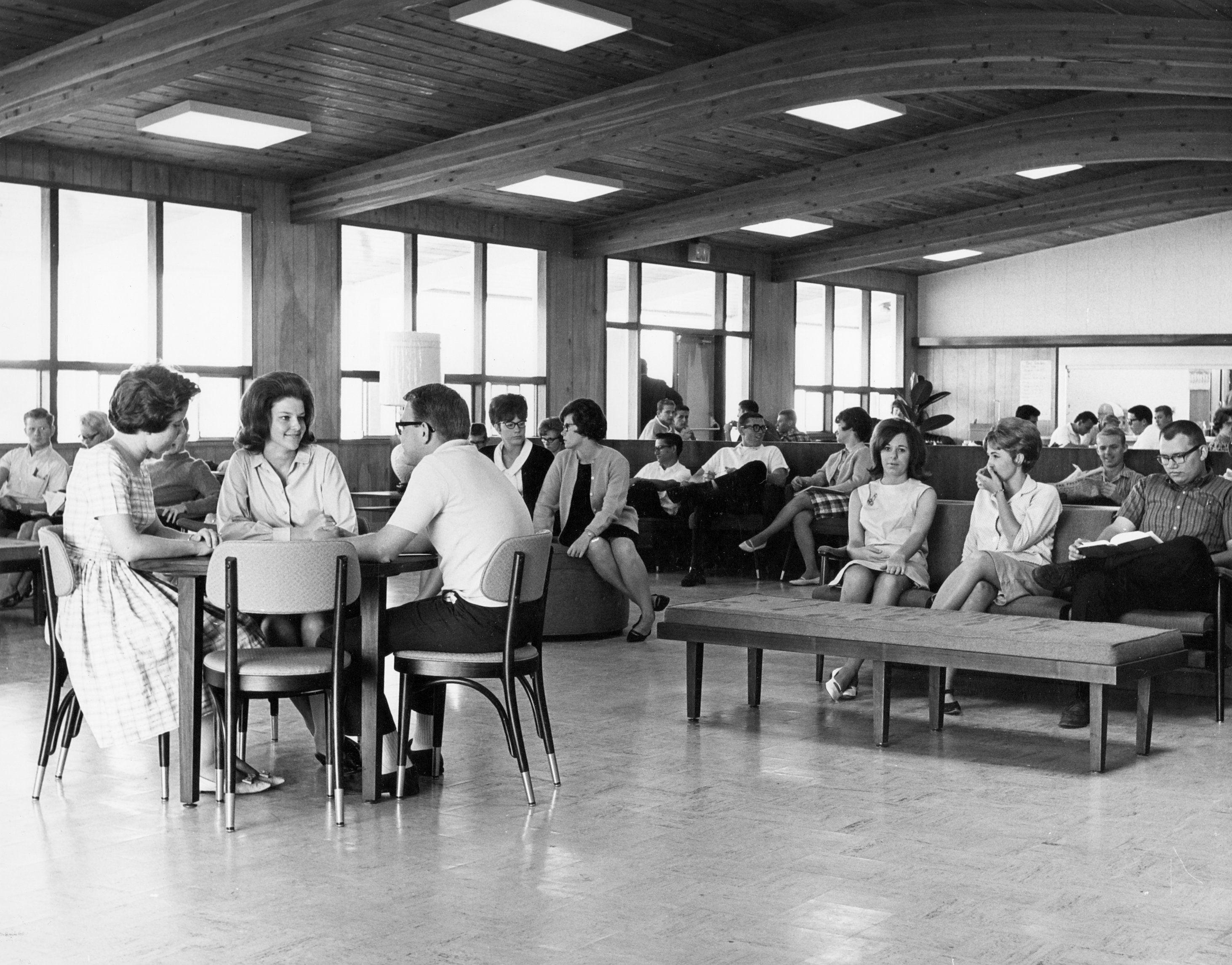 Students meeting in Alumni Hall.