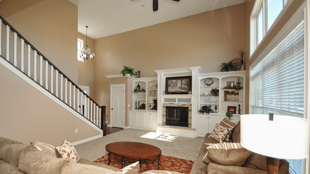 2 story great room of Arlington model with fireplace and ...
