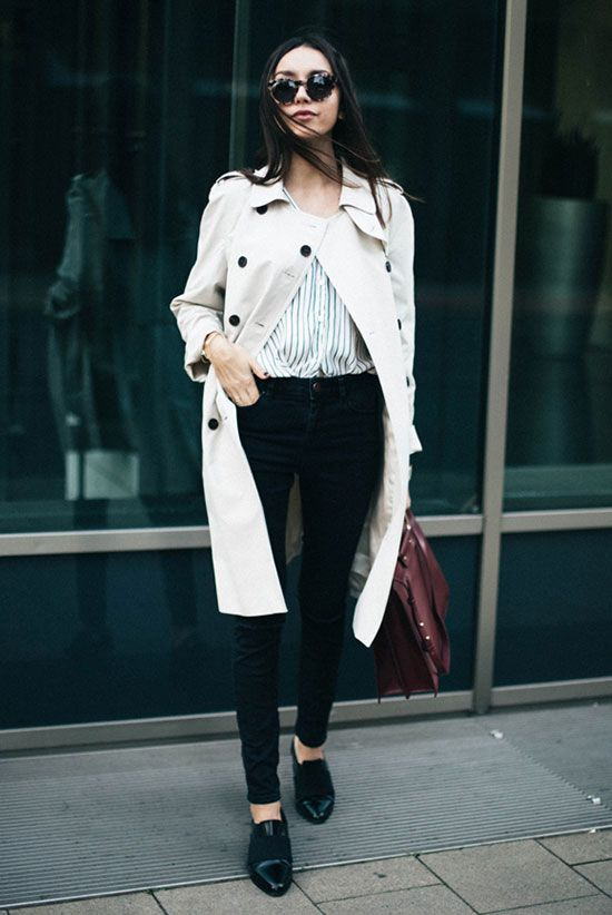 trench coat outfit, spring outfit, fall outfit, work outfit, office outfit, comfy outfit, casual outfit, rainy day outfit, street style - beige trench coat, black stripe shirt, black skinny jeans, black loafers, burgundy tote bag, brown round sunglasses