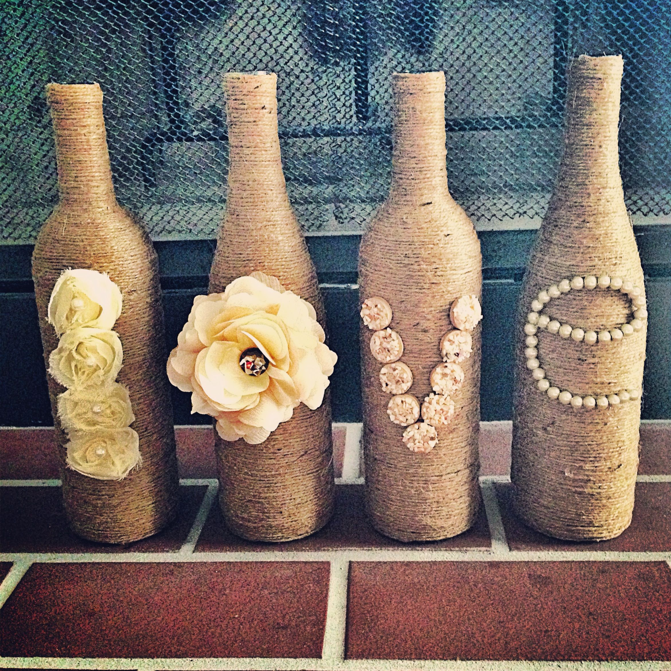 Wine bottles and twine...just saw this exact thing today in a store for sale - super cute! they alternated twine and white rope between letters (L - twine, O-white rope, etc)