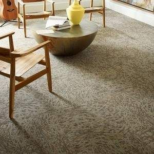 Comprised of recycled Eco Solution Q Nylon fibers and EcoWorx tile backing, these Shaw carpet tiles are a sustainable choice in flooring.