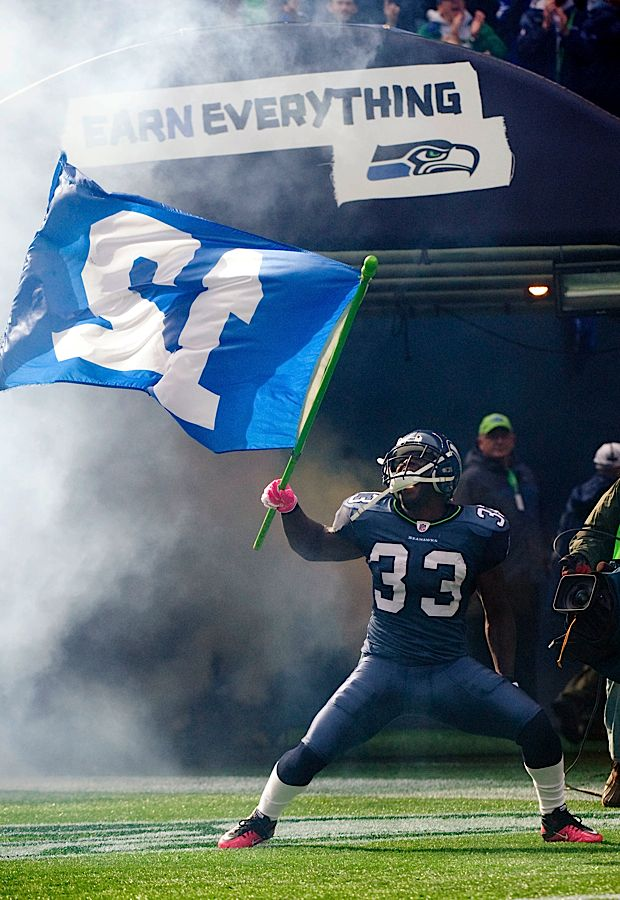 Christine Michael waving the 12th man flag..