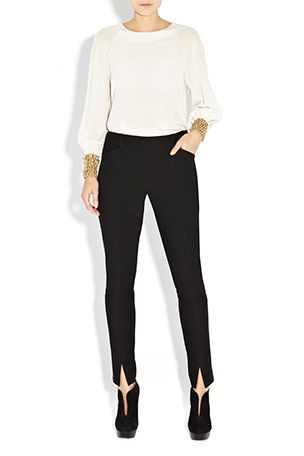 Fans of Bastyan know her beautifully tailored clothing is an investment in the future. The much-sort after Essential Trouser returns for AW12 with these fitted, high waist stretch gabardine trouser with split hem and jersey detailing. An absolute wardrobe essential!