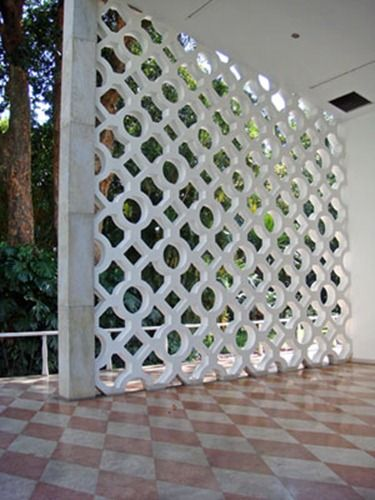 Large painted perforated concrete block wall
