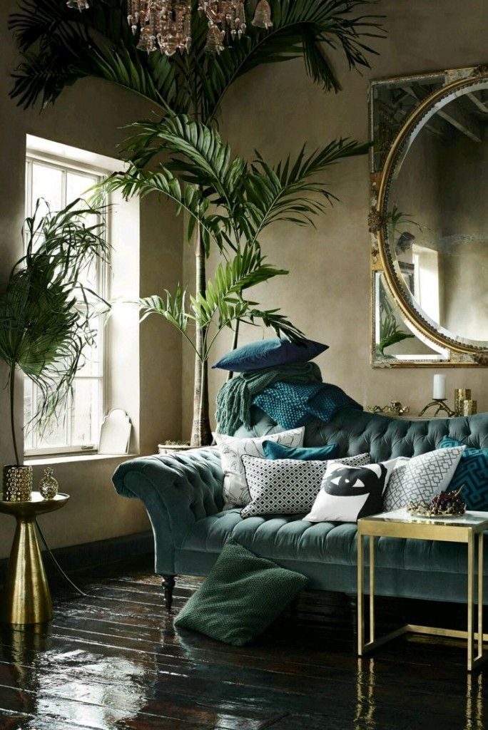 Living Room Feature Wall Decor: Luxe Couch, Giant Mirror, Plants Galore And Gold Accents
