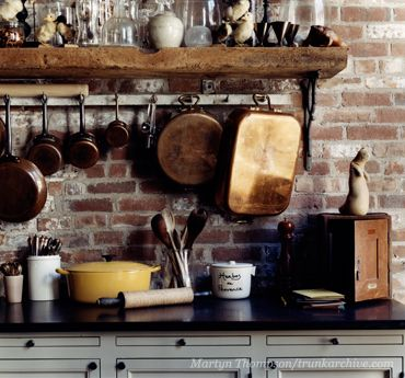 Exposed Brick And Rustic Pots And Pans Maybe Not All Over But One Wall Brick Kitchen Pan Storage Brick Backsplash