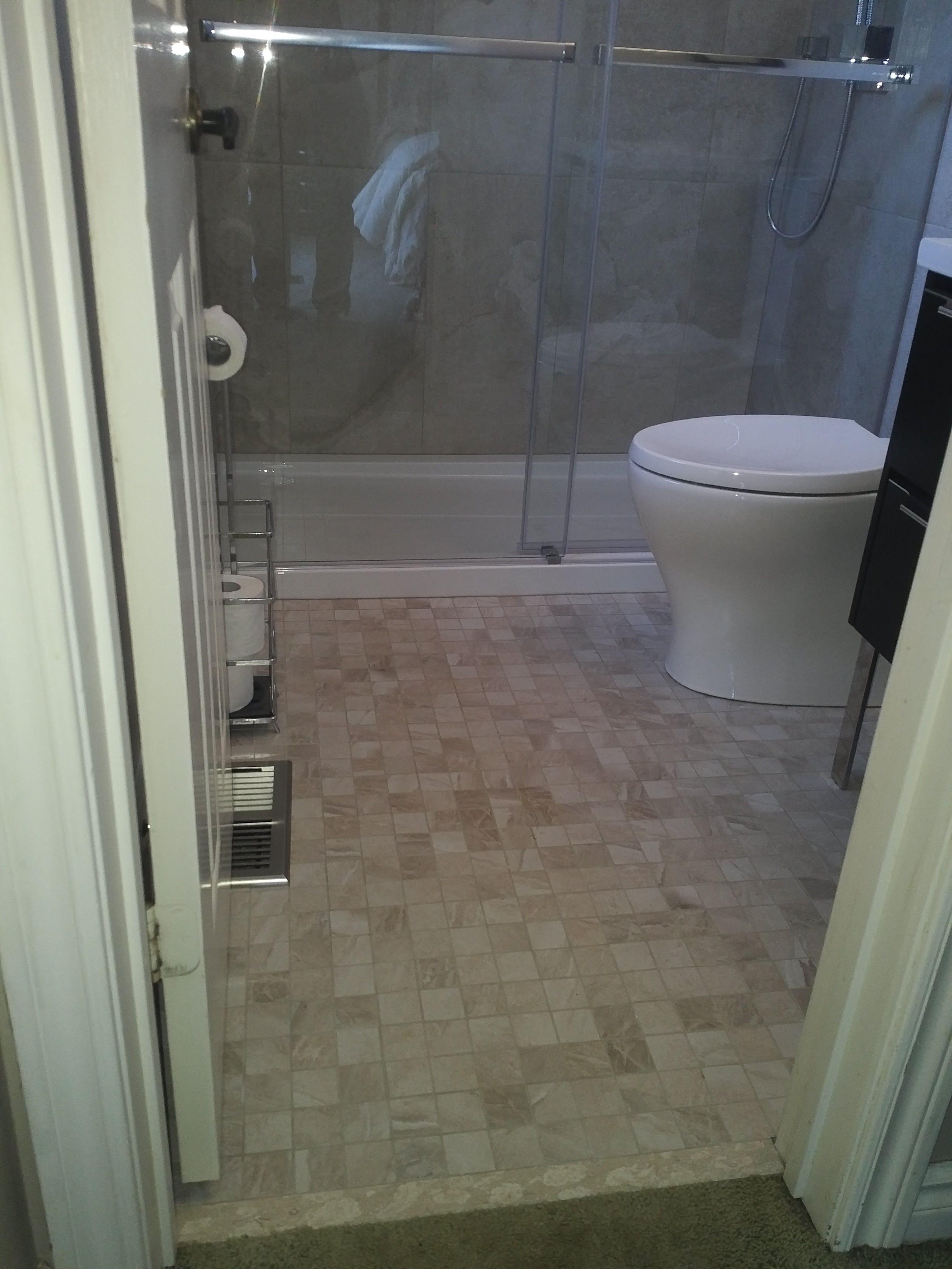 Calgary bathworks calgary bathroom renovations bathroom gallery - Fleurco Gemini Shower Doors With A Kohler Toilet Caledon Tile Renovation