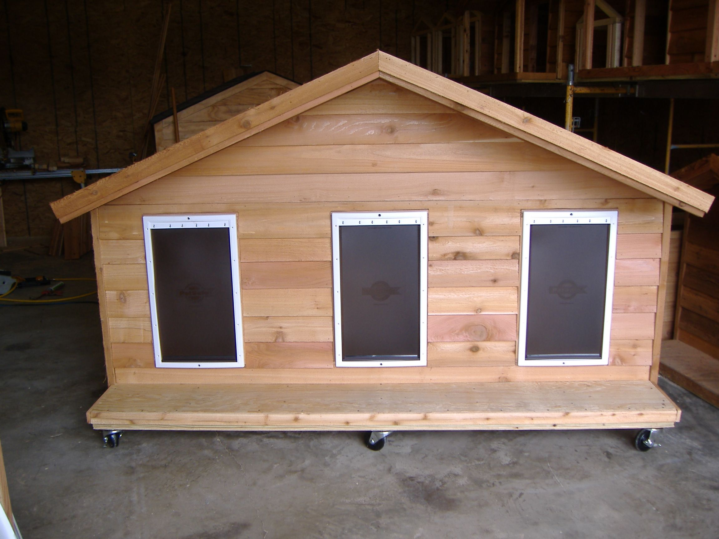 Custom large ac heated heated insulated dog house with for Large insulated dog house