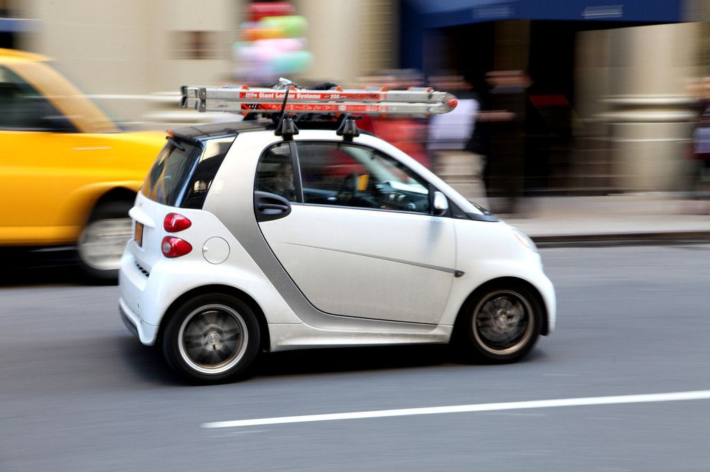 Smart Car With Roof Rack Carrying A Little Giant Step Ladder In New York