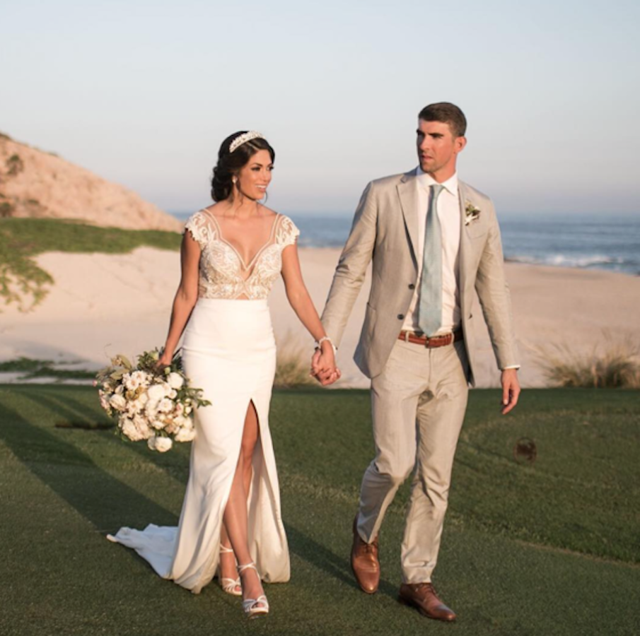 After Secretly Exchanging Vows In June Michael Phelps Nicole Johnson Make It Public With Second Wedding In Cabo Celebrity Wedding Dresses Celebrity Weddings Designer Wedding Dresses