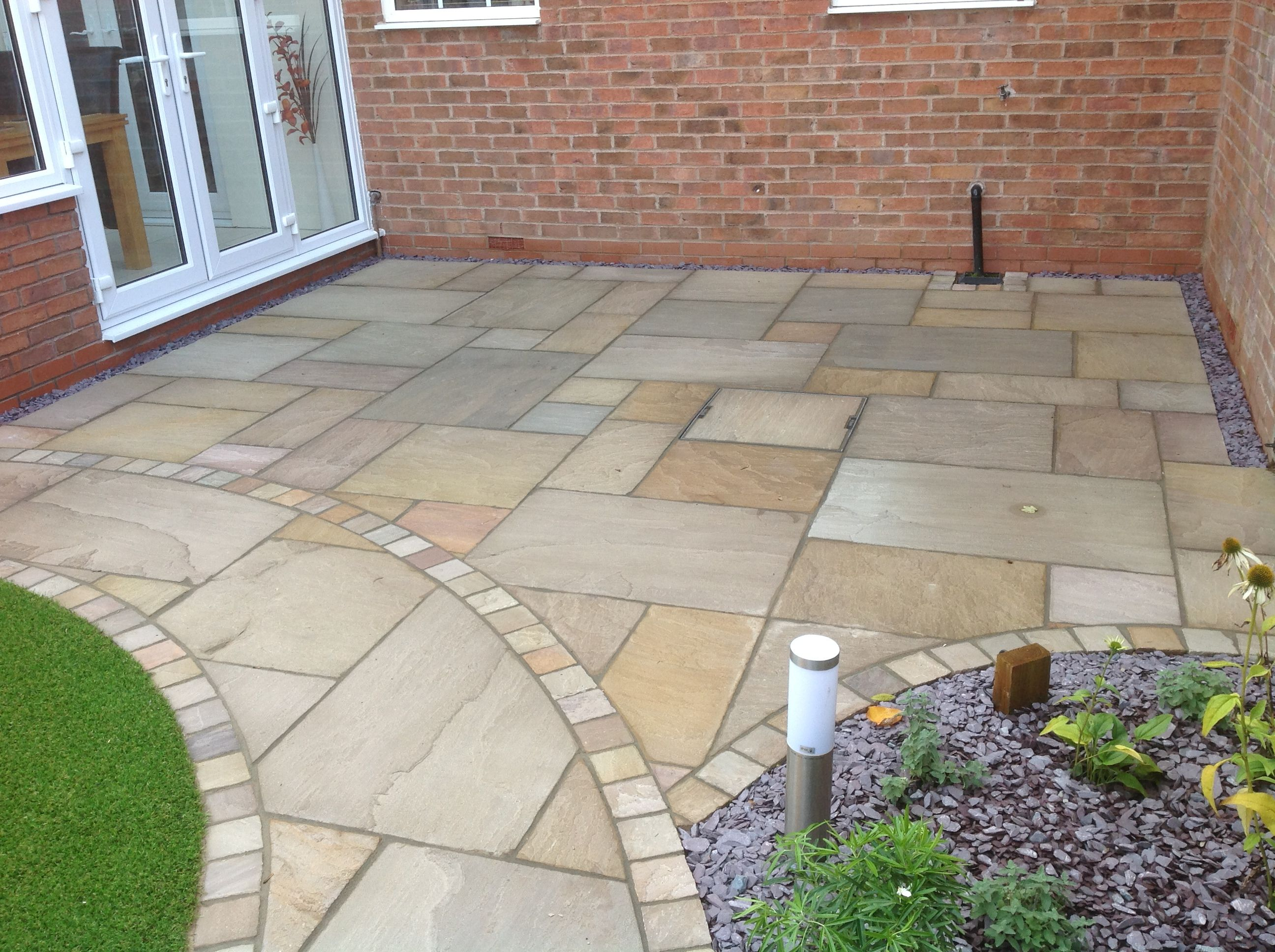 Harvest Blend Sandstone Cobbles Used As A Border For A Sandstone Patio  (Forest Blend)