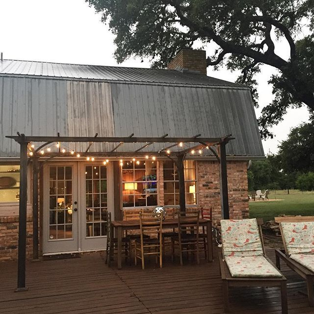 A rainy evening on the back porch @farmhouseonelderhill #shutthefrontporch #simplelivingsaturday #countrylivingmag #galvanized #farmhouse #driftwoodtx #farmhouse #farmhouseonelderhill