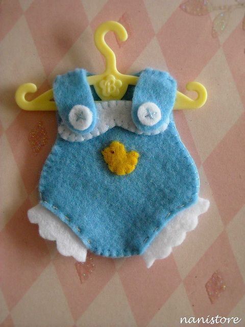 This example, made with felt, would be perfect for a baby shower. You could use scraps of cloth for other styles of clothing, though.