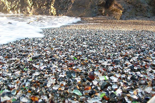 Glass Beach can be found in MacKerricher State Park close to Fort Bragg.  It's an old dumping ground used by the locals during the 20th century.  Since the dumps closure in 1967 it has had many various cleaning projects to try and tidy the beach up.  With these cleanups and almost 50 years of waves pounding the shores it has left a remarkable site.  A beach with small, smoothed colored pieces of glass and pottery instead of sand.