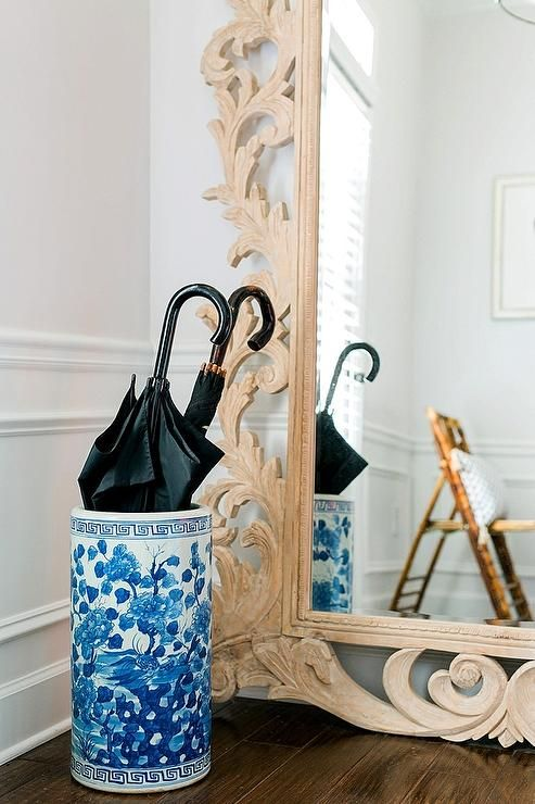 Chic Foyer Features A Restoration Hardware Rococo Leaner Mirror And