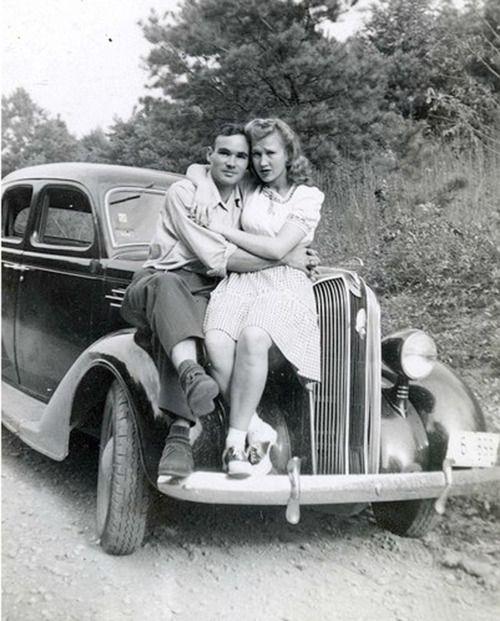 vintage black white photo. couple on car.