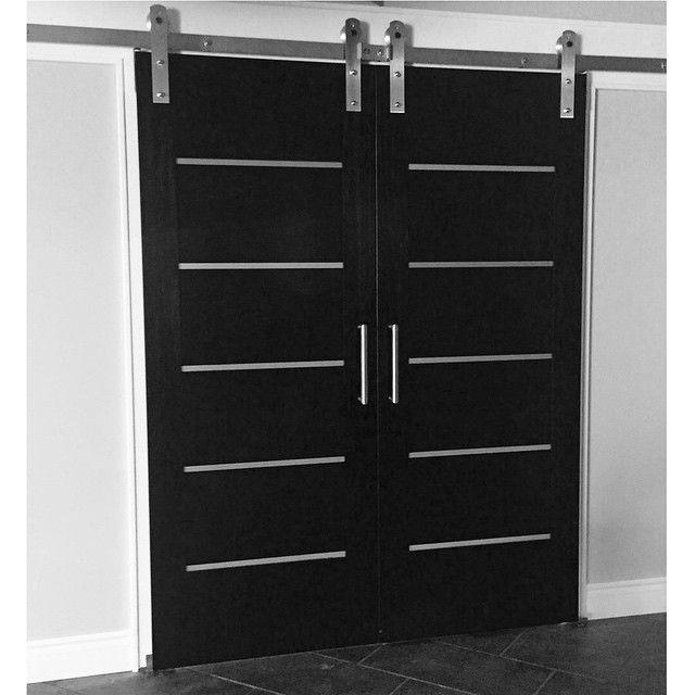 This Modern Black Sliding Door Is Sleek And Amazing Love The Grey Details In The Paneled Door Barn Style Interior Doors Inside Barn Doors Barn Door