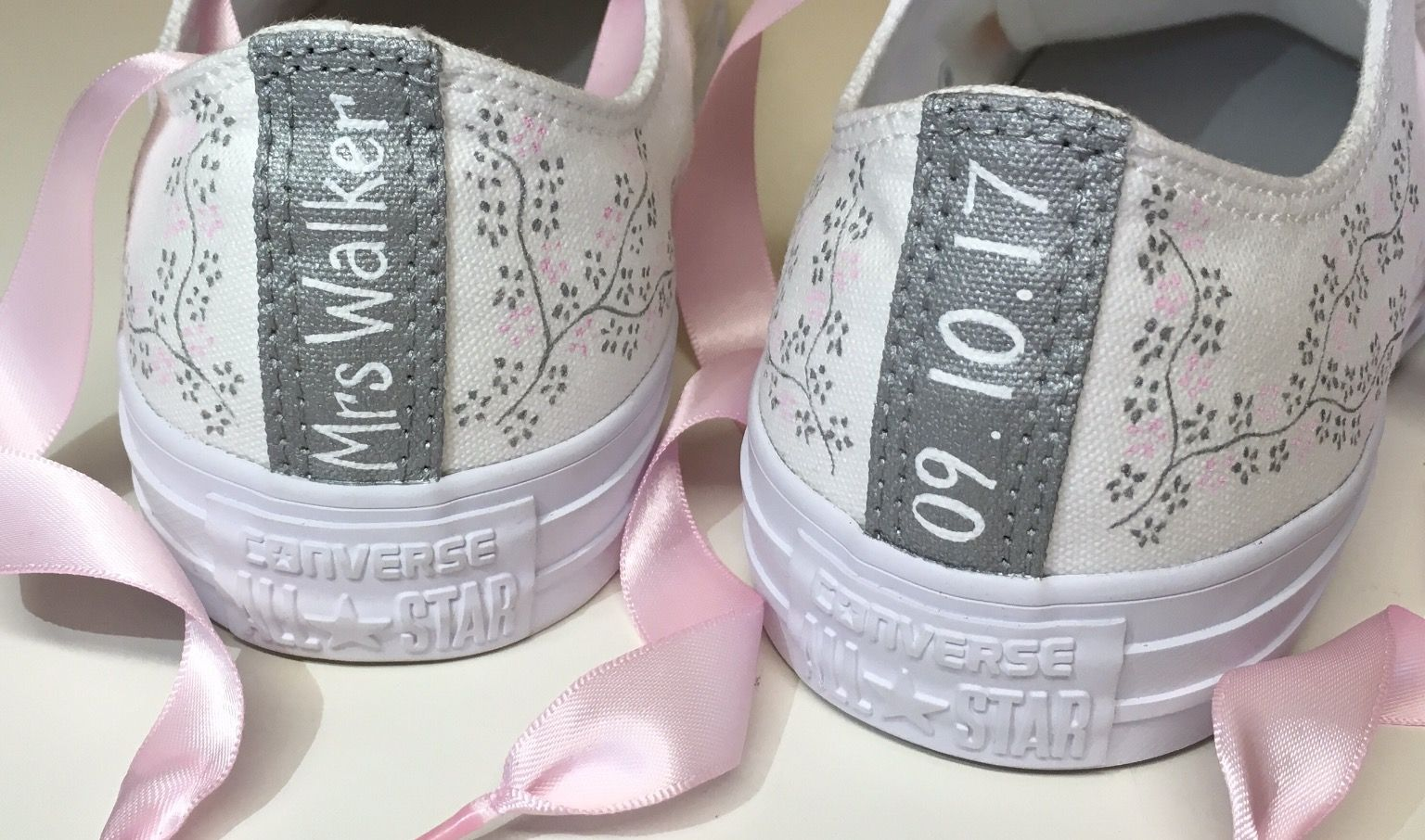1c2710ad0873 Floral Wedding Converse with Personalised Heel Tags and Light Pink Ribbon  Laces  wedding  fashion  converse  bride  personalised  floral   weddingconverse   ...
