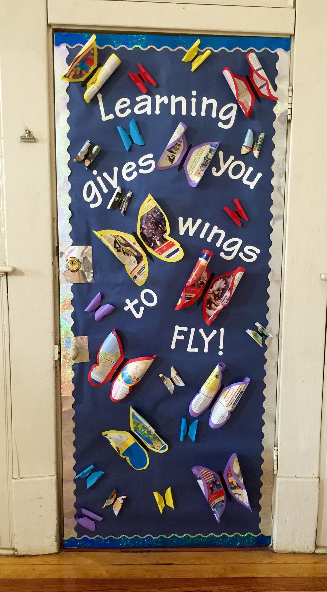 """Back to School bulletin board or door idea! """"Wings to Fly!"""" Wings are butcher paper and old textbook pages."""