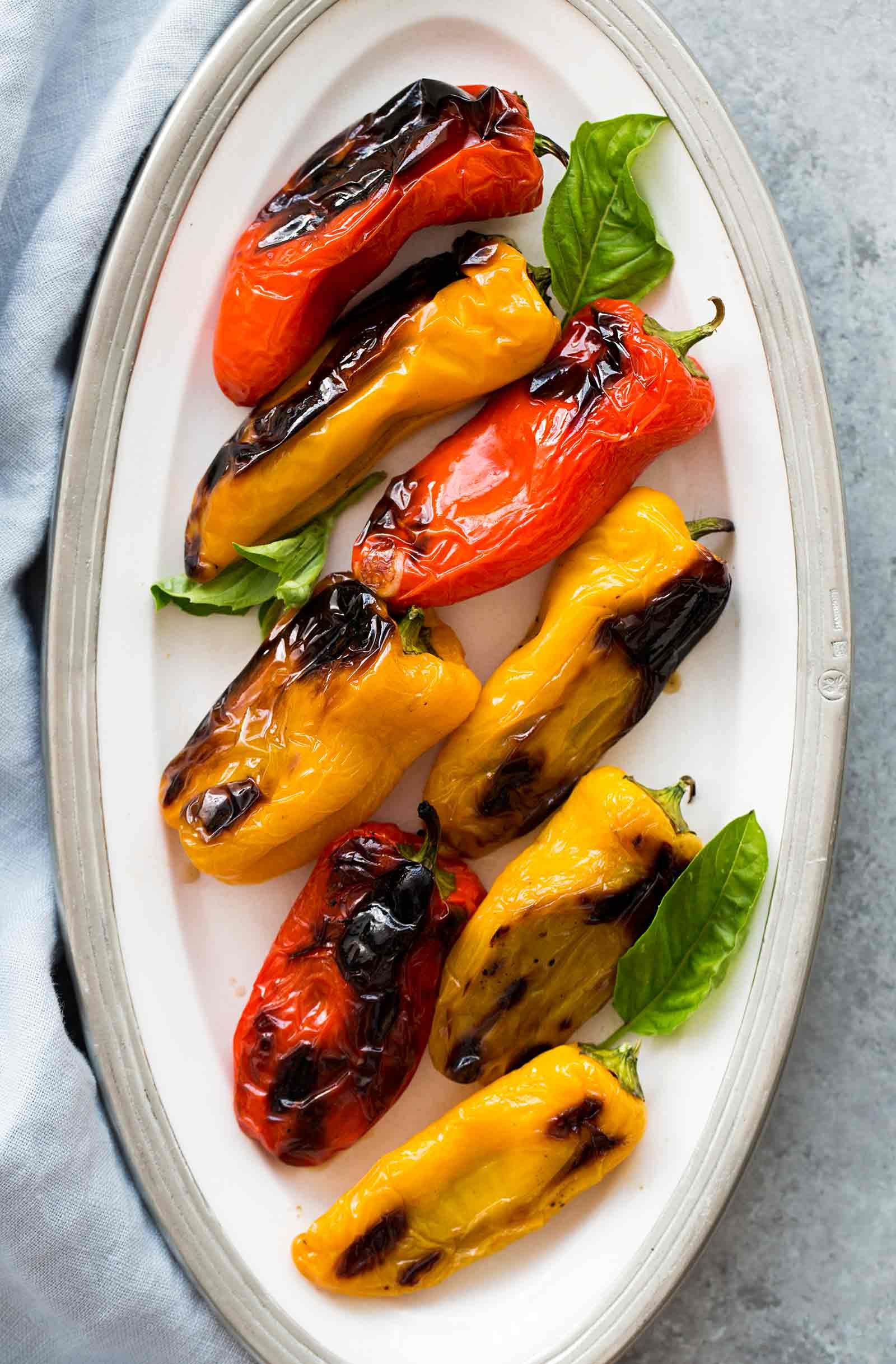 Mozzarella Stuffed Sweet Mini Peppers Recipe Simplyrecipes Com Recipe Stuffed Peppers Mini Peppers Recipes Stuffed Mini Peppers