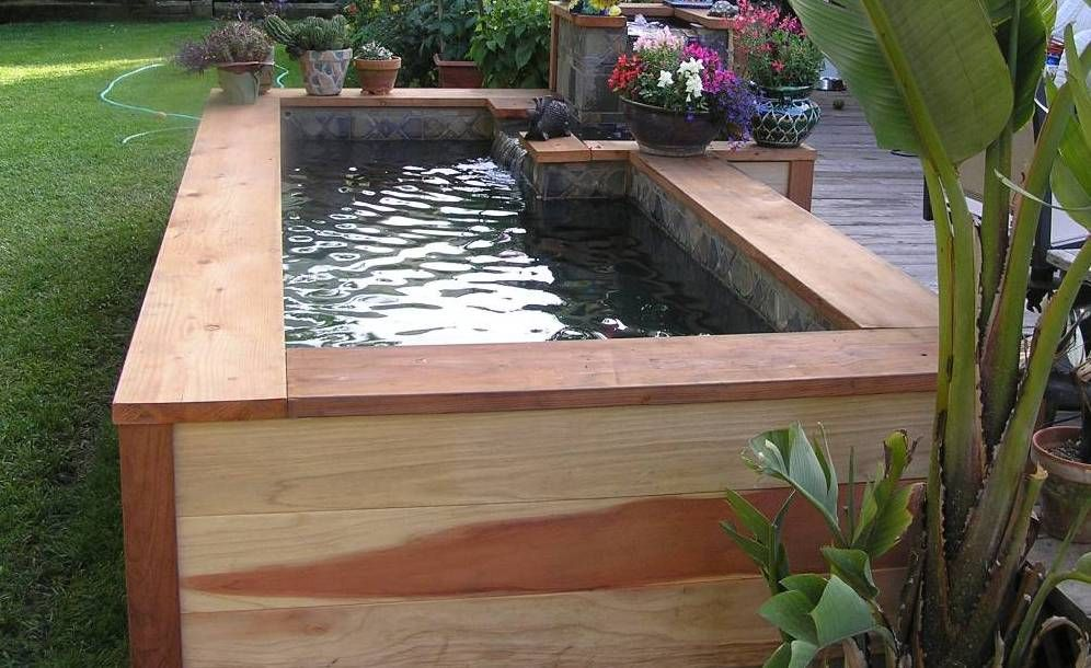 Wooden outdoor raised ponds raised ponds landscaping for Wooden koi pond construction