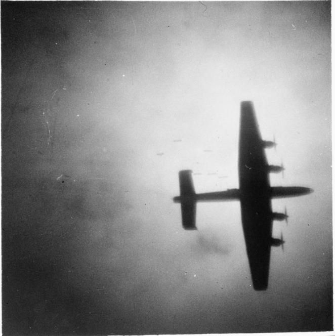 'The bomber would always get through' – but many wouldn't make it back. Here a No.4 Group Halifax is silhouetted as it by fires as it flies over the burning German city of Leipzig. (IWM C 3972)