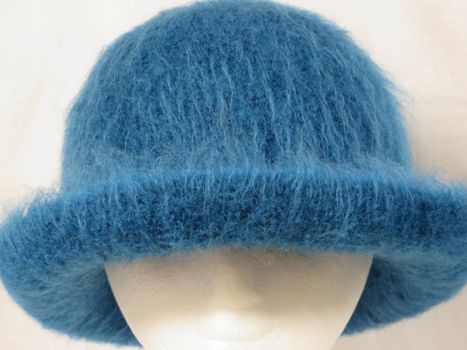 Hat Wool Felted Peacock Blue with Rolled Brim by DebGHats on Etsy https://www.etsy.com/listing/210359300/hat-wool-felted-peacock-blue-with-rolled