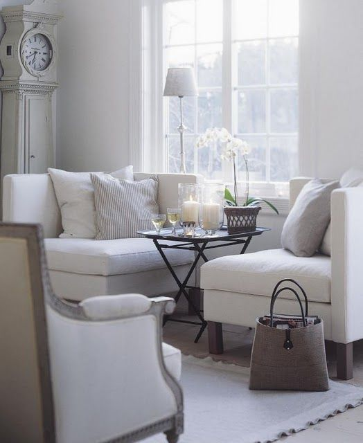 I LOVE the cozy feeling grouping the corner wedges around a small table. I LOVE, LOVE, LOVE the tote as a magazine rack!!!! This is a great option in place of the traditional couch!!! Great use of space! ❤ This will work in a spot where I want to put a couch, but floor vents would be covered!
