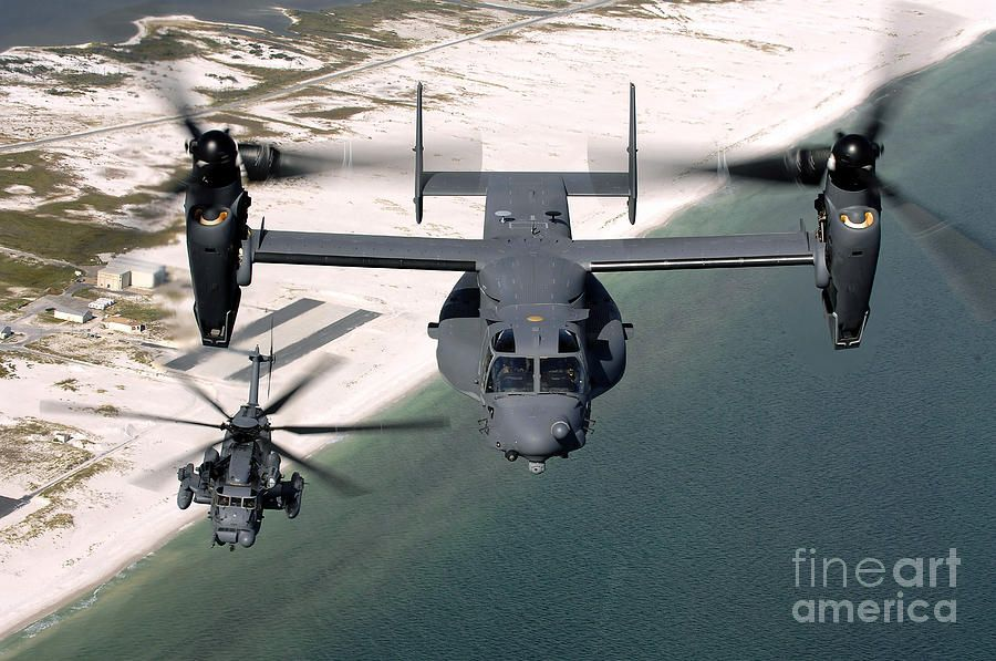 A Cv22 Osprey And An Mh53 Pave Low Military helicopter